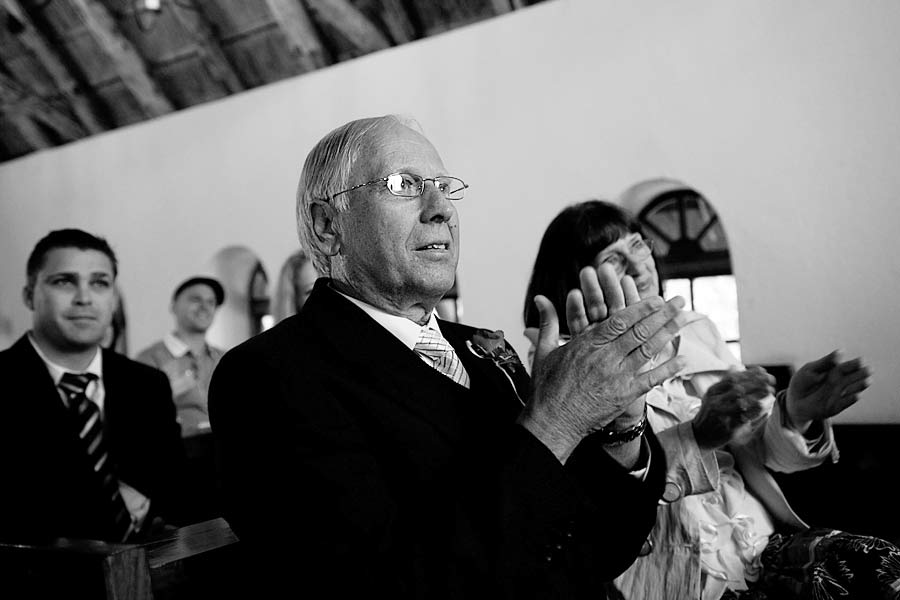 Father of the Bride claps at the wedding ceremony
