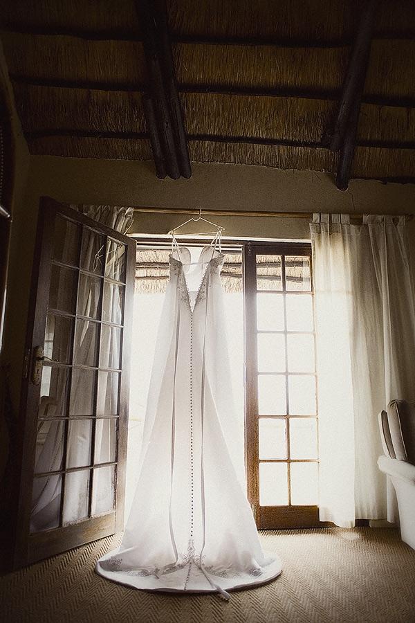 Wedding Dress hanging up during bridal preparations