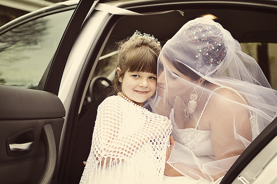 Reportage wedding photography of flower girl with bride