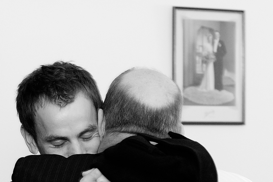 Groom and his father hugging