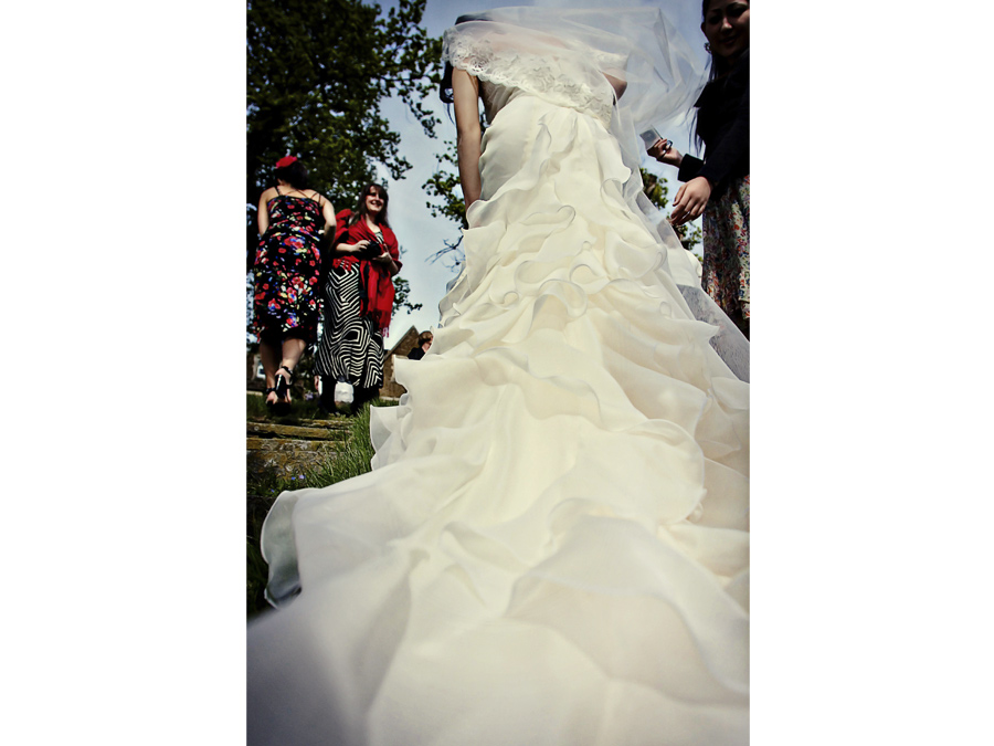 Spanish style wedding dress worn by Japanese bride