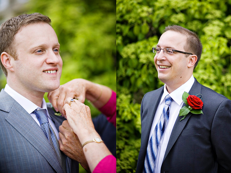 Groom pinning on buttonhole at Hartsfield Manor, Betchworth